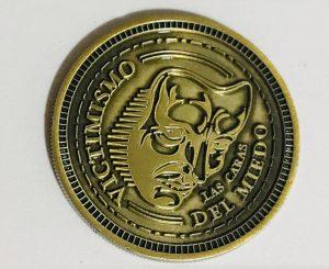 Moneda de lasCaras del Miedo2 300x245 - Tienda